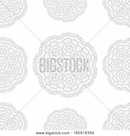 Gray and white fantasy seamless pattern with ornamental round doodle flower isolated on white background.