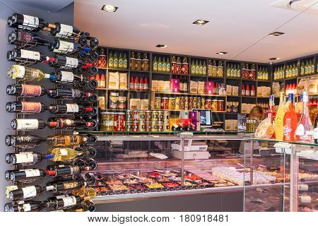 FRANCE, AIX-EN-PROVENCE- MAY 7, 2016: Shelves with wine bottles in food supermarket