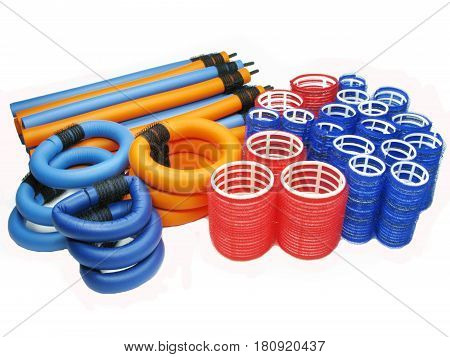 collection of red blue and orange hair rollers different diameter