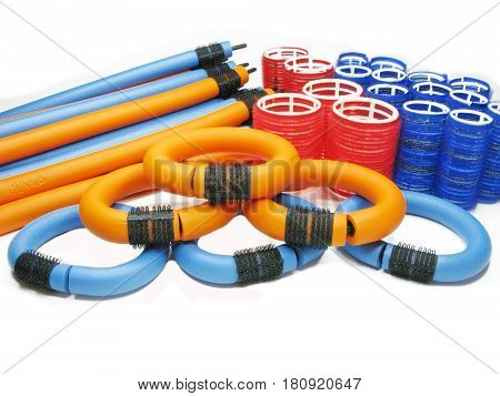 collection of red blue and orange hair rolls different diameter