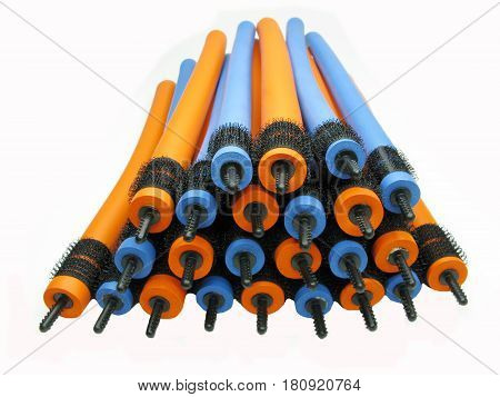 collection of orange and blue hair rollers different diameter