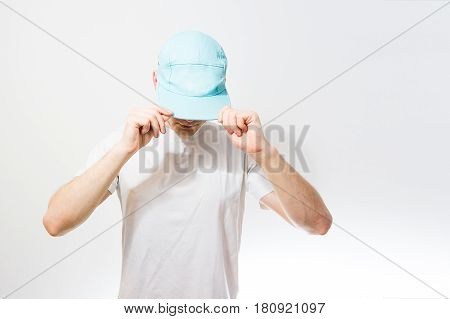 The Man, Guy In The Blank White, Turquoise  Baseball Cap,  On A White Background, Mock Up, Free Spac