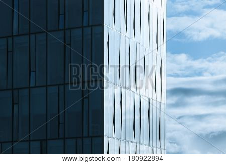 Corner Of Modern Office Building And Cloudy Sky