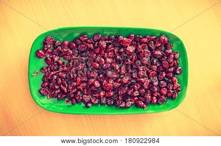 Vitamins food good for kidneys. Plate bowl full of red dried cranberries