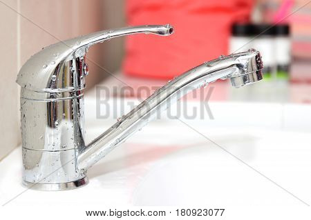 Close-up water tap. Working water tap. Bathroom