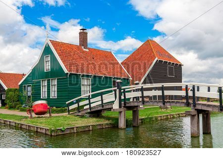 Typical wooden houses and small creek in famous village of Zaanse Schans, Netherlands.