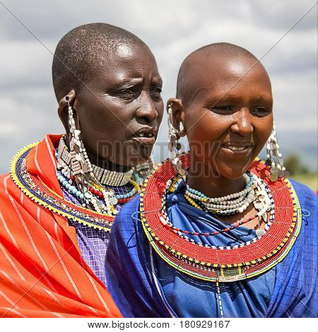 Africa Tanzania - February 2016: Masai women of the tribe in a village in traditional dress.