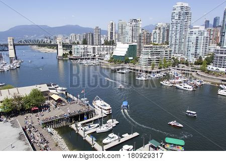 The view of False Creek harbor with Davie Village skyline in a background (Vancouver British Columbia).