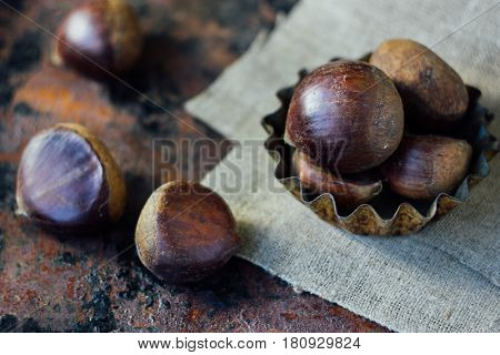 Chestnuts Over Rustic Background
