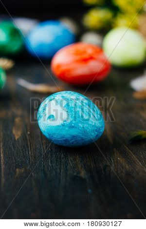 Blue Easter Egg Like Planet Earth On Brown Wooden Table.