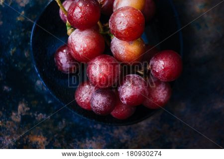 Bunch Of Grapes On Black Plate. Top View.