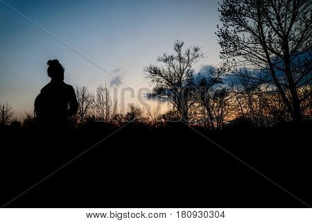 yung woman looking on sunset in park