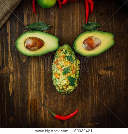 Funny Food Face Made From Avocado And Guacamole Dip.