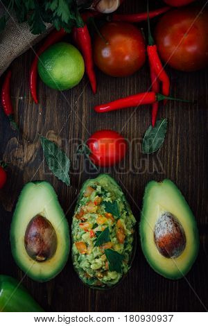 Guacamole And Fresh Avocado On Wooden Table.