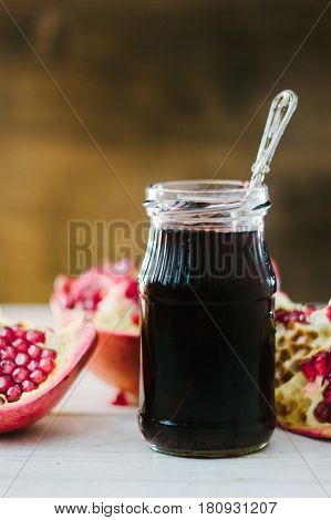 Organic Pomegranate Sauce On Glass Bottle With Spoon