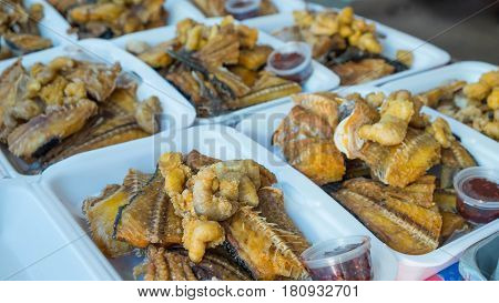 Fish and spawn fried with chili , Fish fried in the market