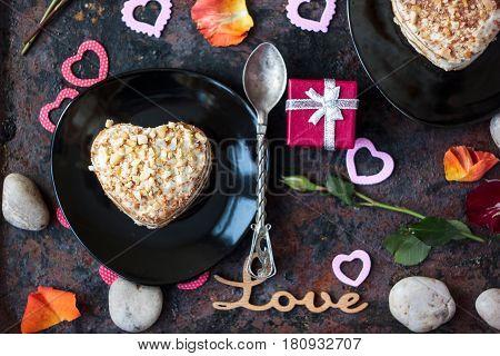 Dessert For Valentine's Day Celebration On Black Plate.