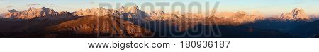 Evening sunset colored panoramic view of Alps Dolomites mountains from Col di Lana Civetta Pelmo Tofana Fanes Cristallo Antelao and others Italian dolomites Italy