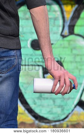 A Photo Of A Bully Who Spoils State Property, Paints Walls With Aerosol Paint