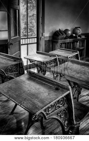 Vintage Schoolroom - old schoolroom desks in aged monochrome