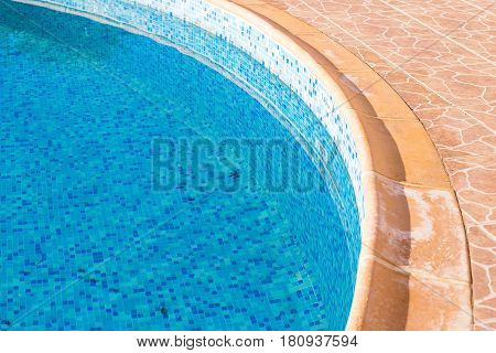old swimming pool in hotel with blue water