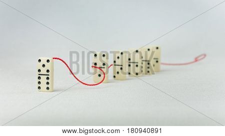 Leadership concept. One domino figure represent major person lead further items in red tow.
