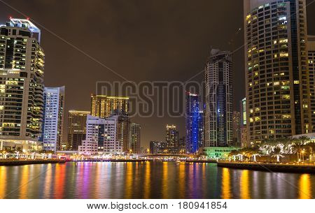 Skyscrapers in Dubai Marina at night reflection in the water. United Arab Emirates ( UAE ). Beautiful cityscape.