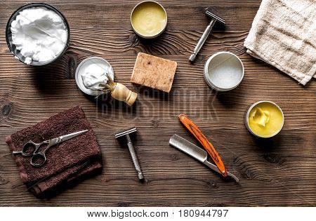 babrer workplace with tools for shaving on wooden table background top view