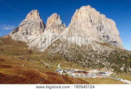 View of Sella Joch pass and mounts Langkofel Plattkofel Sassopiatto Sassolungo South Tirol Dolomites mountains Italy