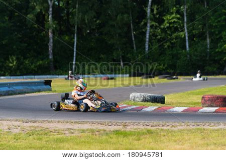 OLDENZAAL NETHERLANDS - JUNE 7 2016: Karter taking a sharp curve on an outdoor karting track