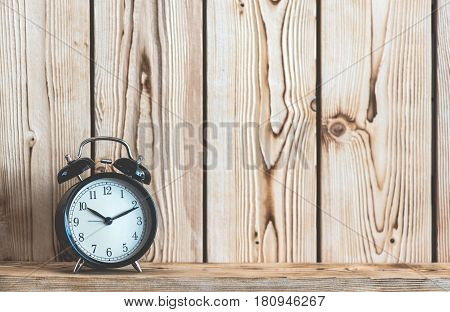 Time Concept With Alarm Clock On Wooden Shelf