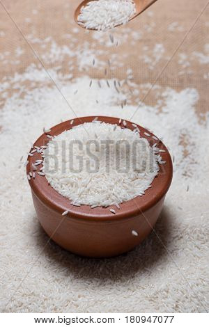 Rice in spoon and bowl. Jasmine Rice Thai Rice White Rice.