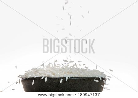 White Rice falling down. Jasmine Rice Thai Rice Raw Rice.