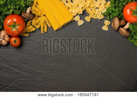Italian food concept. Pasta ingredients. Cherry-tomatoes spaghetti pasta rosemary and spices