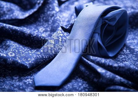 Blue tie on a blue shirt. Elegance style
