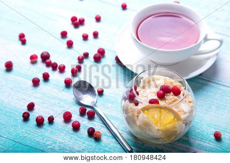 Summer dessert in glass with  pear, cowberry and fruit tea.