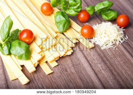 Italian raw Pasta Fettuccine on the wood background