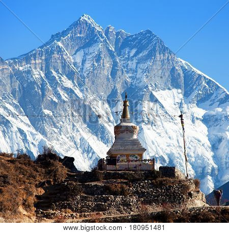 Stupa near Namche Bazar and Mount Lhotse south rock face - way to Everest base camp - Nepal