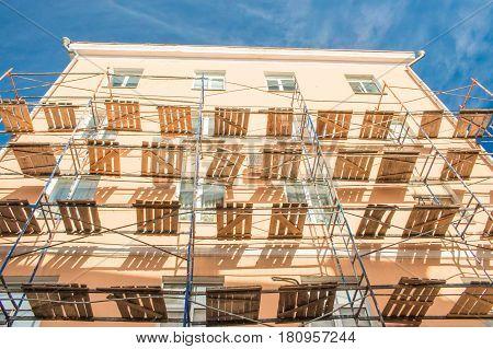 Scaffolding On Renovation Of House Bright Sunny Day Blue Sky