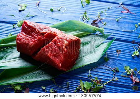 Beef meat loaf Veal loin on blue wood background