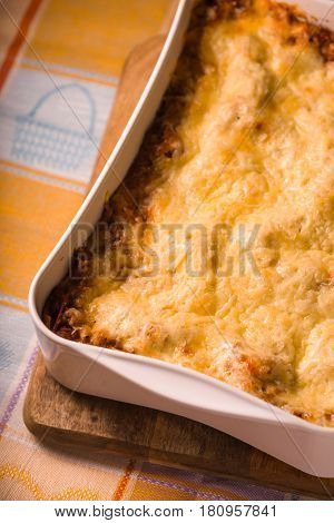 Lasagne cooked at home in large form for baking diagonal vertical
