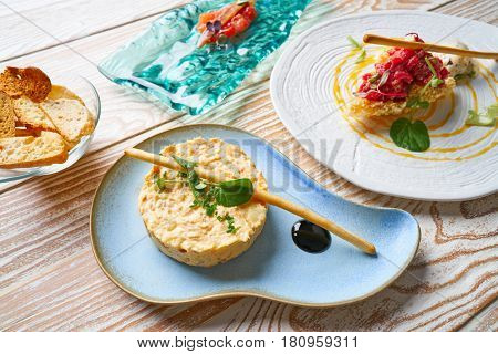 food starters potato salad Steak tartare and Anchovies with tomato Tapas