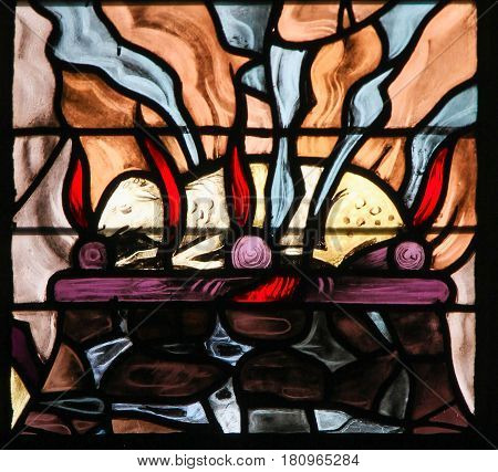 Stained Glass Of A Burning Lamb, Symbolizing The Agnus Dei