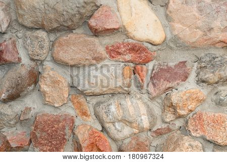 Masonry made of natural granite boulder close-up
