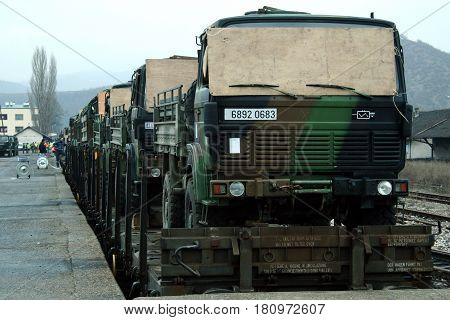 MITROVICA KOSOVO - FEBRUARY 17 2009: French army truck being shipped on a train ready to leave the train station of Kosovska Mitrovica as a part on the agreement to reduce the amount of NATO KFOR troops in the area