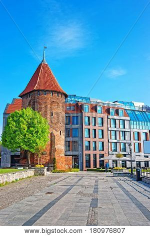 Gdansk, Poland - May 7, 2014: Swan Tower in the old town of Gdansk Poland. People on the background