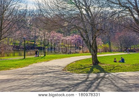 HOLMDEL NEW JERSEY- APRIL 9 - People enjoy a sunny Spring day in Holmdel Park on April 9 2017 in New Jersey.