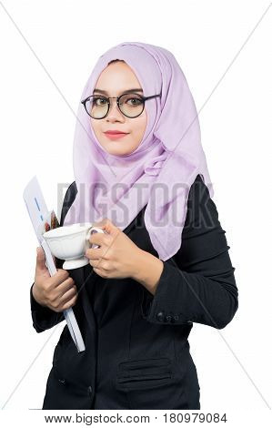 Beautiful modern Young Asian Muslim business woman holdinga coffee cup and reportsisolated on white background.