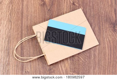 Contactless Credit Card And Paper Shopping Bag, Concept Of Cashless Paying For Shopping