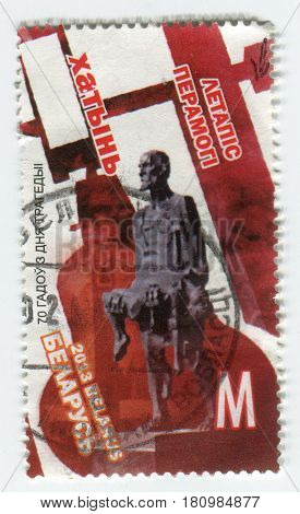 GOMEL, BELARUS, APRIL 8, 2017. Stamp printed in Belarus shows image of  The Khatyn was a village of 26 houses and 156 inhabitants in Belarus, Minsk Region, 50 km away from Minsk, circa 2013.